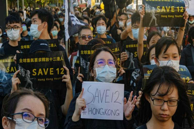 Hong Kong pro-democracy activists caught at sea go on trial in China under National Security Law