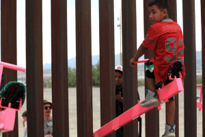 US-Mexico wall, pink swing to fly over.  The idea won the prestigious Design of the Year award