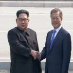 north korean leader kim jong un shakes hands with south korean president moon jae in as both of them arrive for the inter korean summit at the truce village of panmunjom, in this still frame taken from video